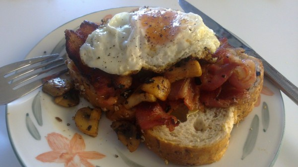 Small free range egg, mushrooms, bacon, butter, bread. Yum!